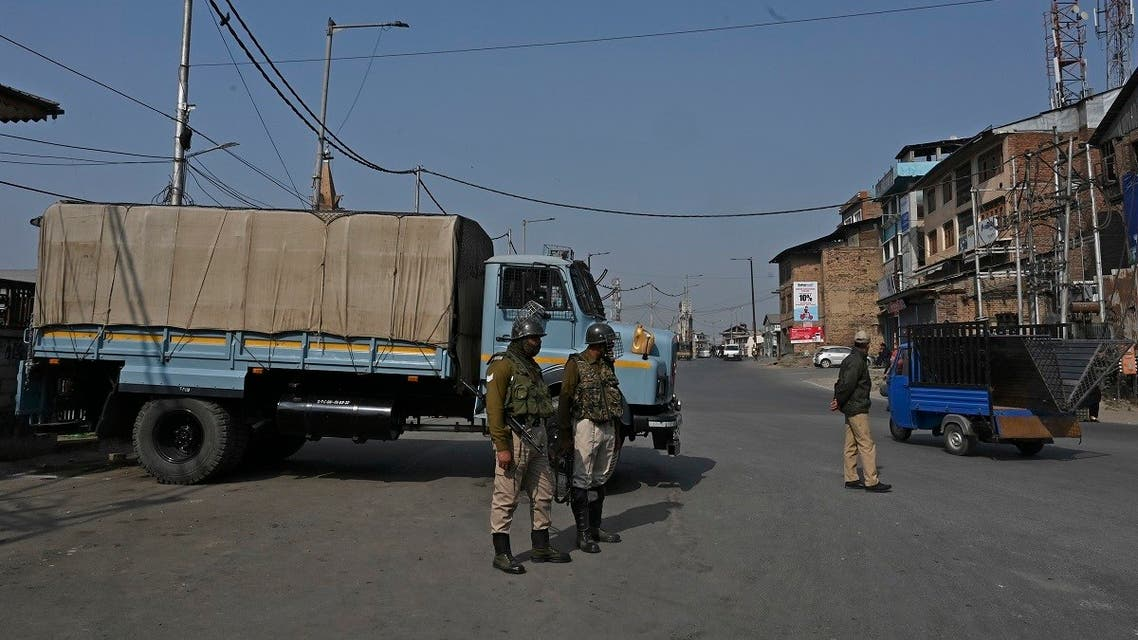 Indian government forces stand guard at a road check point during a one-day strike called by the All Parties Hurriyat Conference (APHC) against Indian government decision to open Kashmir land for all Indians, in Srinagar, October 31, 2020. (Tauseef Mustafa/AFP)