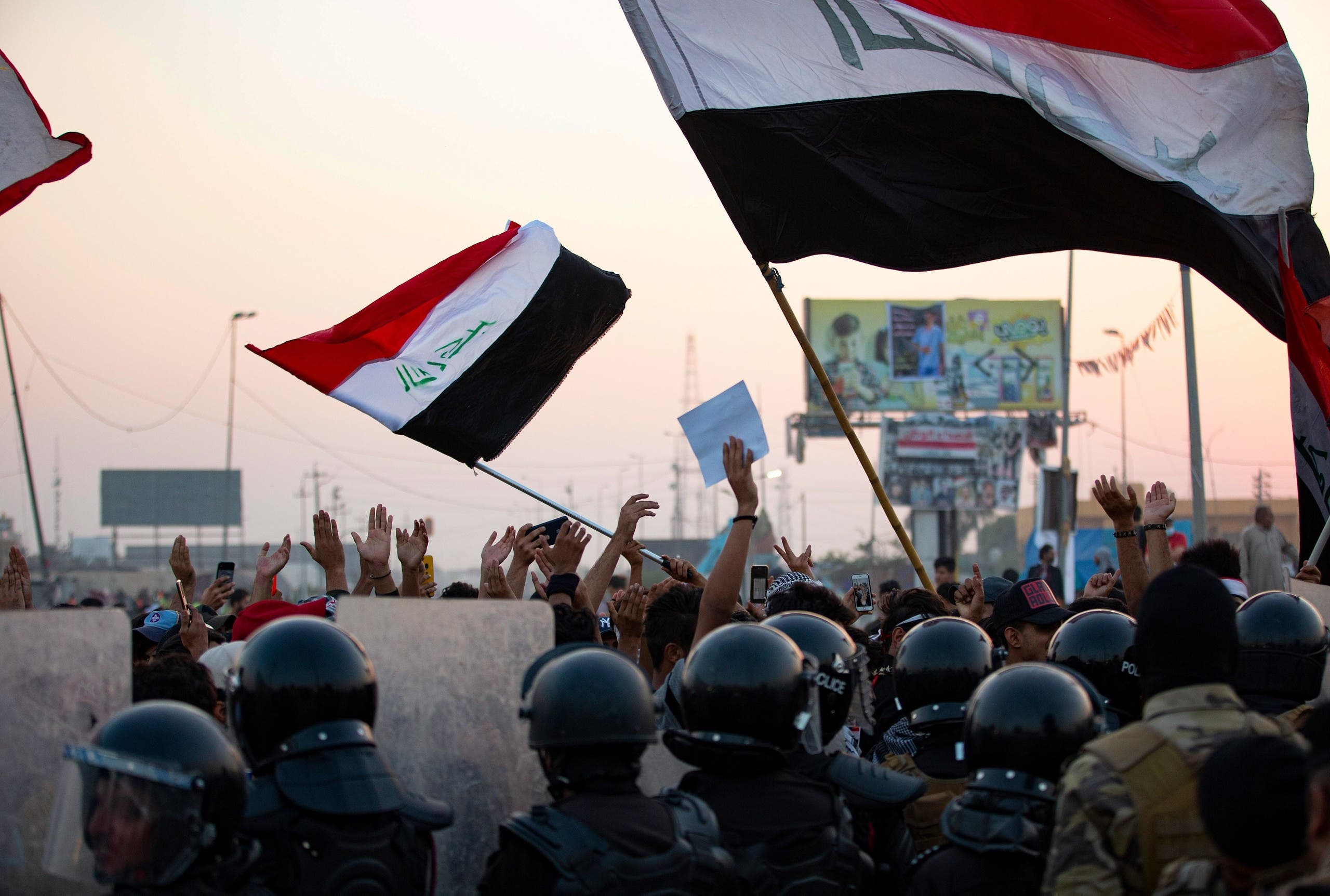 Iraqi anti-government protesters confront security forces as the latter attempt to break up a demonstration, remove their tents and reopen roads, in the southern city of Basra, on October 31, 2020. (AFP)