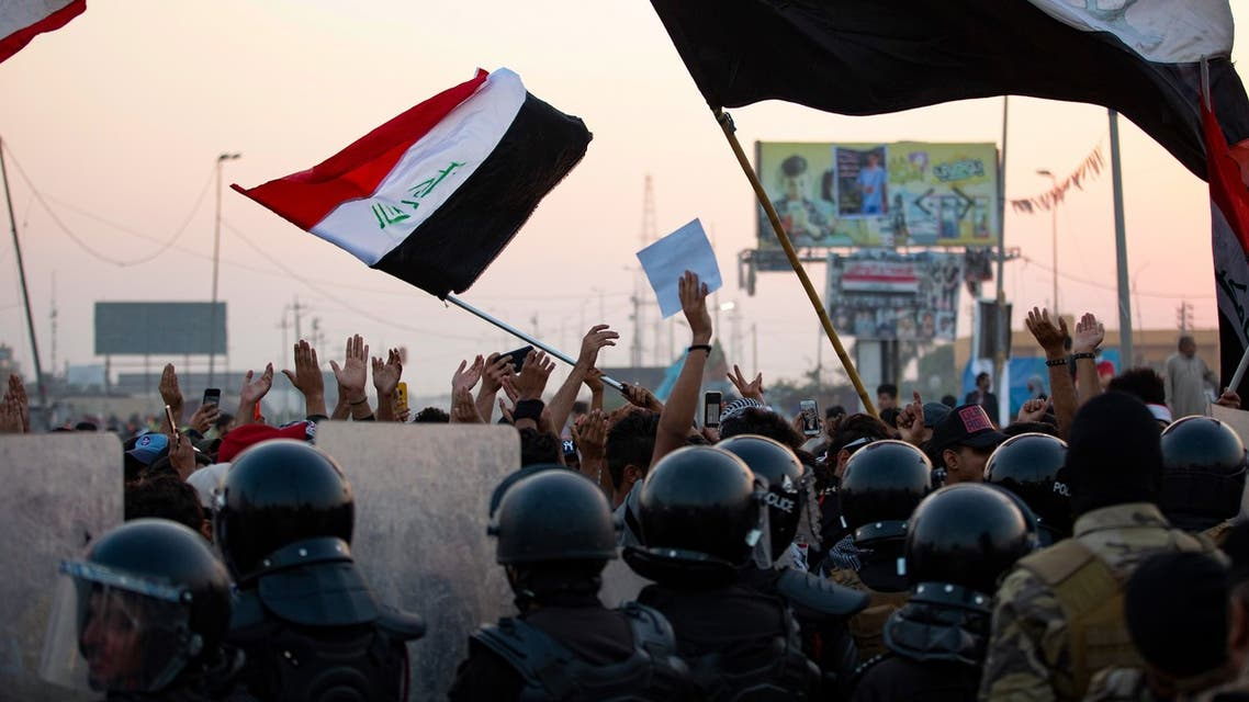 Iraqi anti-government protesters confront security forces as the latter attempt to break up a demonstration, remove their tents and reopen roads, in the southern city of Basra, on October 31, 2020.