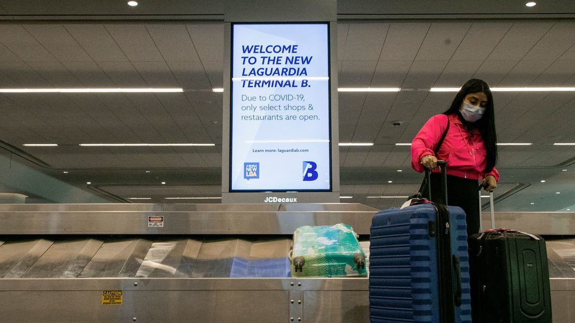 A sign alerts travelers to the danger of COVID-19 at LaGuardia Airport, during the outbreak of the coronavirus disease (COVID-19), in New York. (Reuters)
