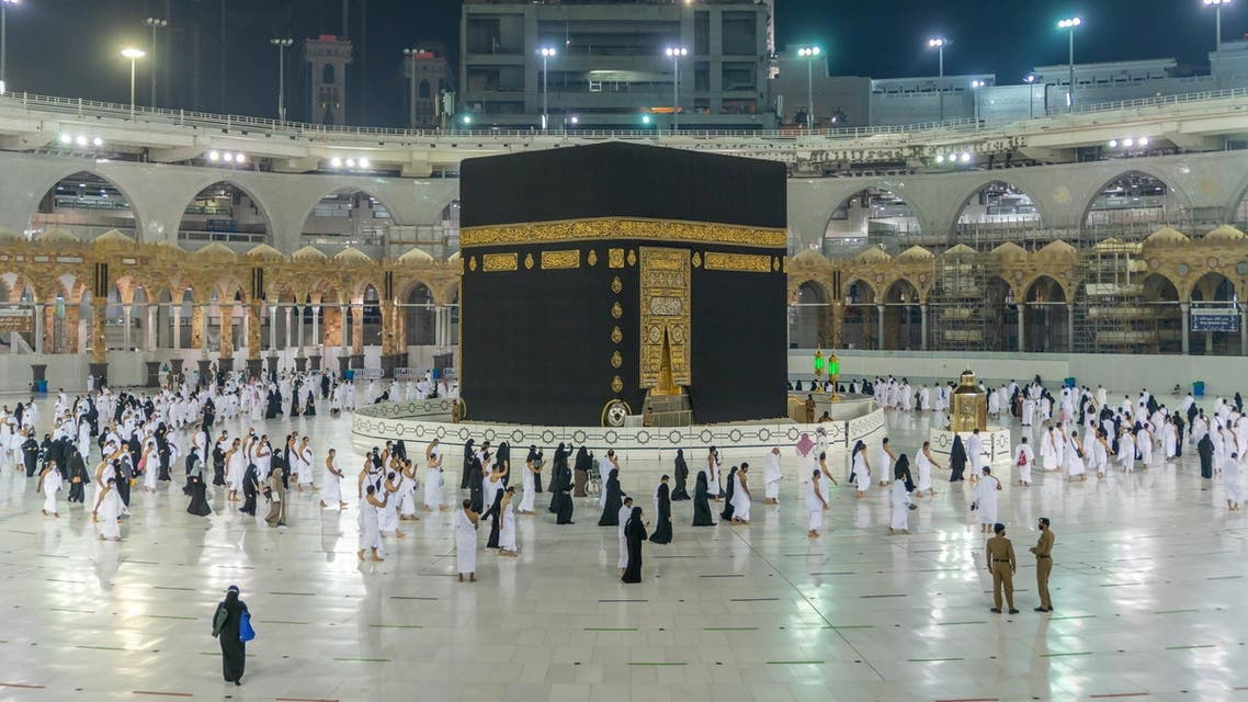 Muslims, keeping a safe social distance, perform Umrah at the Grand Mosque after Saudi authorities eased the coronavirus disease (COVID-19) restrictions, in the holy city of Mecca, Saudi Arabia, November 1, 2020. (Reuters)