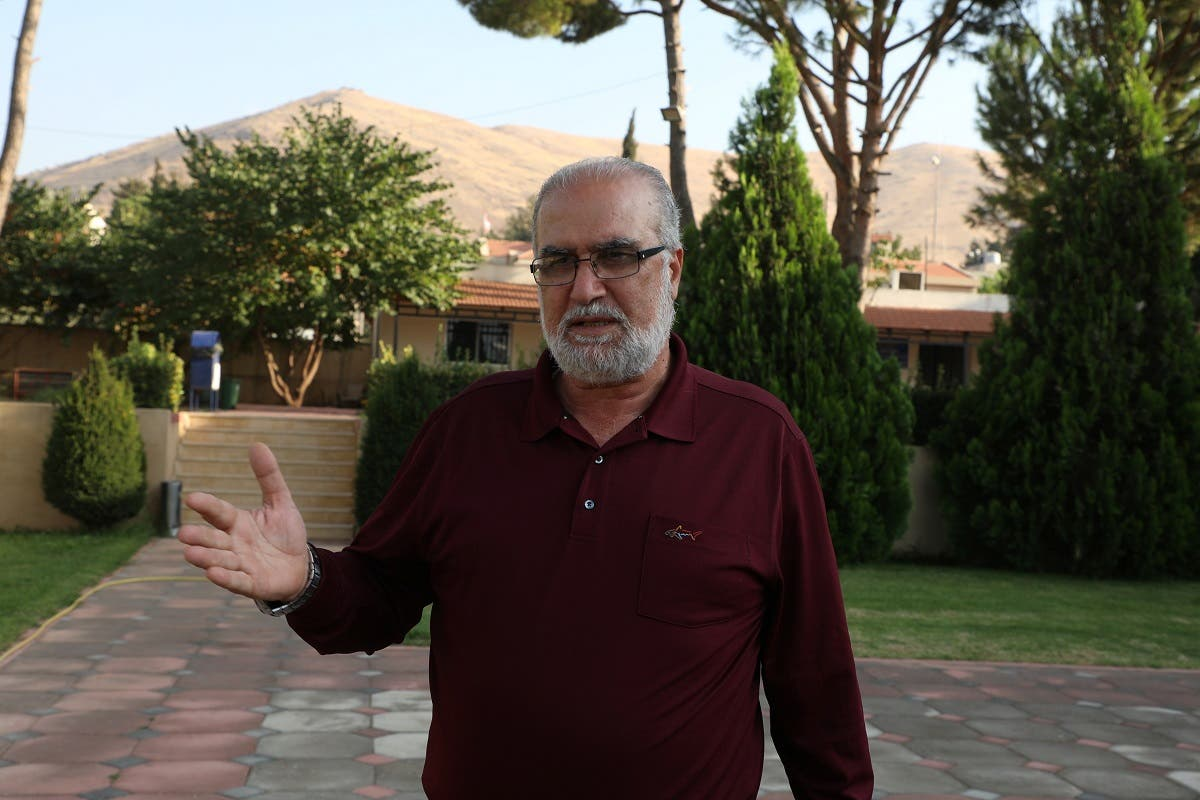 Vartkes Khoshian, head of the municipality in Lebanon's largely Armenian town of Anjar, gestures as he talks, in Anjar, Lebanon October 21, 2020. Picture taken October 21, 2020. (Reuters/Mohamed Azakir)