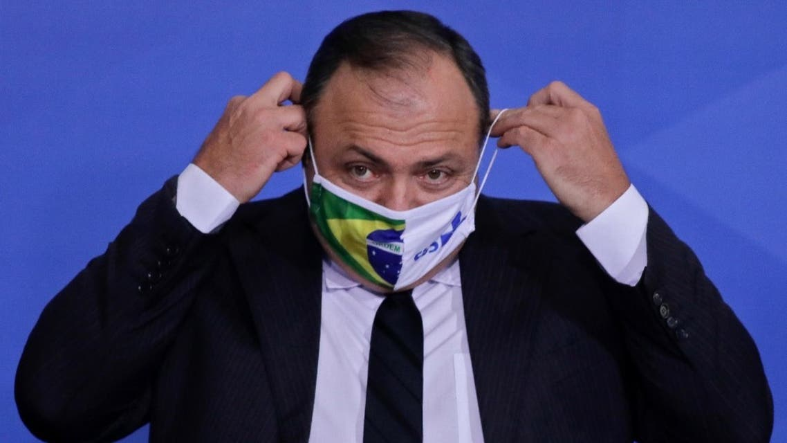 Brazilian Army General Eduardo Pazuello puts on a facemask during his inauguration ceremony as Minister of Health at the Planalto Palace, in Brasilia, on September 16, 2020. (AFP)