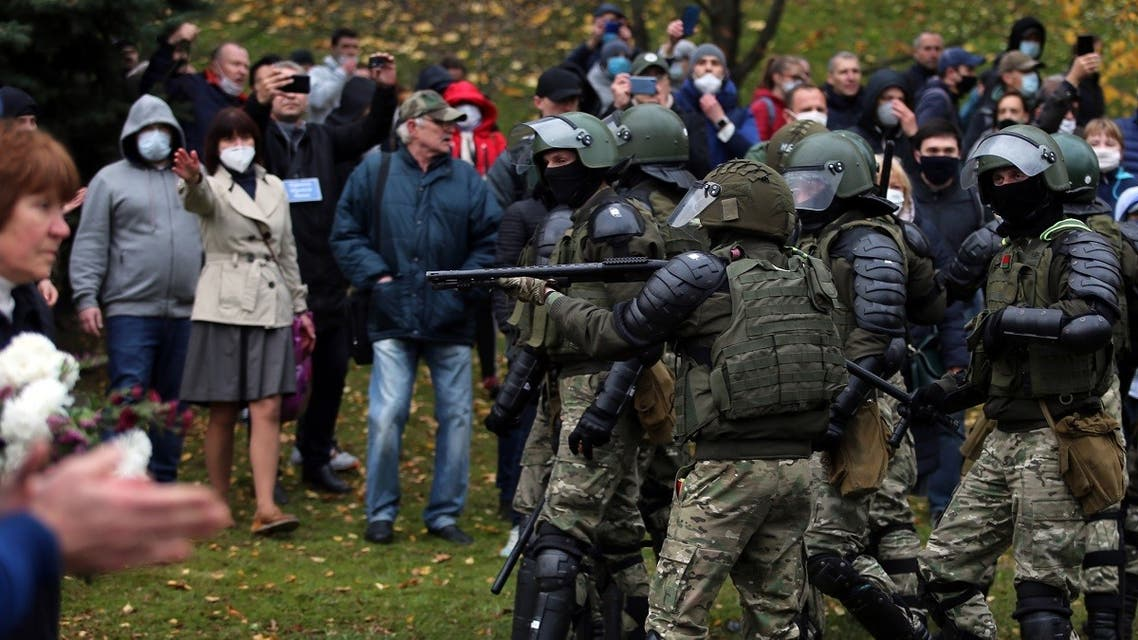 Law enforcement officers block protesters during a march of opposition supporters from central Minsk to a site of Stalin-era executions just outside the capital on November 1, 2020. (Stringer/AFP)