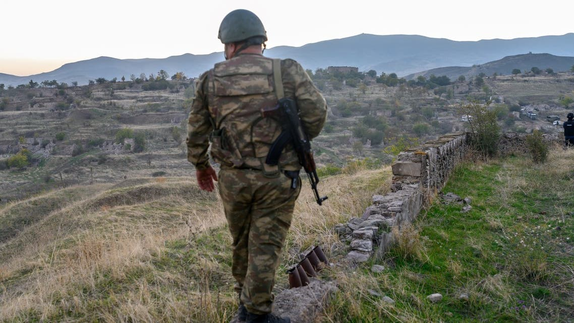 An Azeri soldier stands in the city of Jabrayil, where Azeri forces regained control during the fighting with Armenia over the breakaway region of Nagorno-Karabakh on October 16, 2020. Fresh explosions rocked the capital of the disputed Nagorno-Karabakh region on October 16 as Azerbaijan claimed fresh advances in nearly three weeks of fighting that have claimed more than 700 dead.