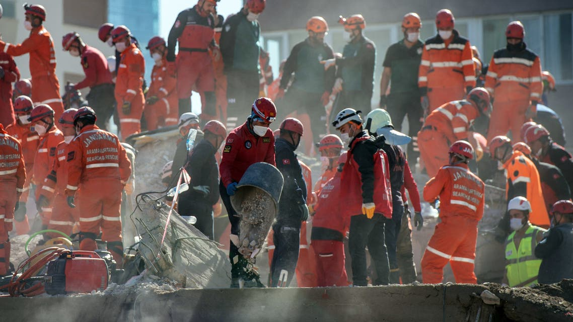 Rescuers are at work during the ongoing search operation at the site of a collapsed building as they look for survivors and victims in the city of Izmir. (AFP)