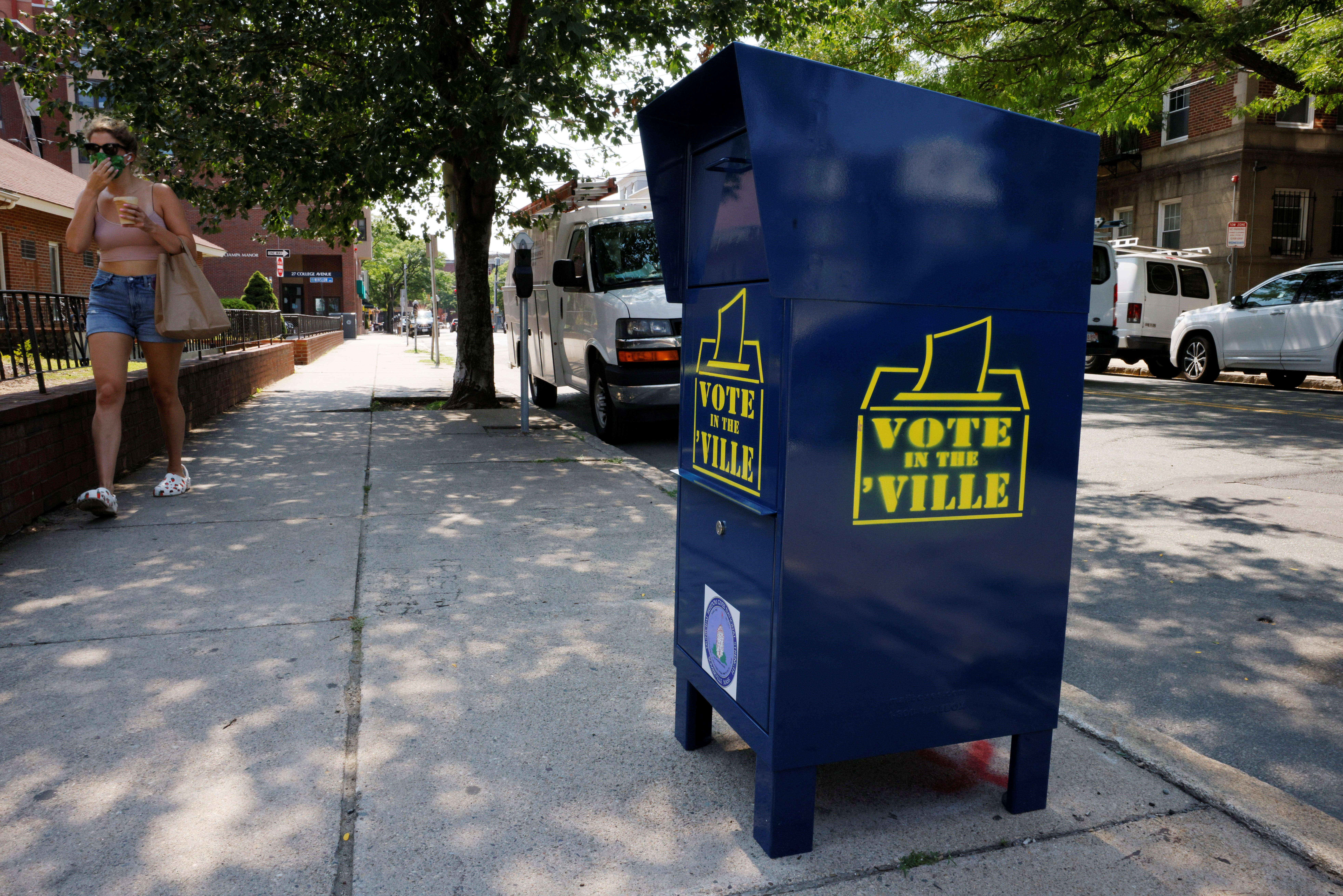 A box to drop off ballots stands on a sidewalk in Somerville. (Reuters)