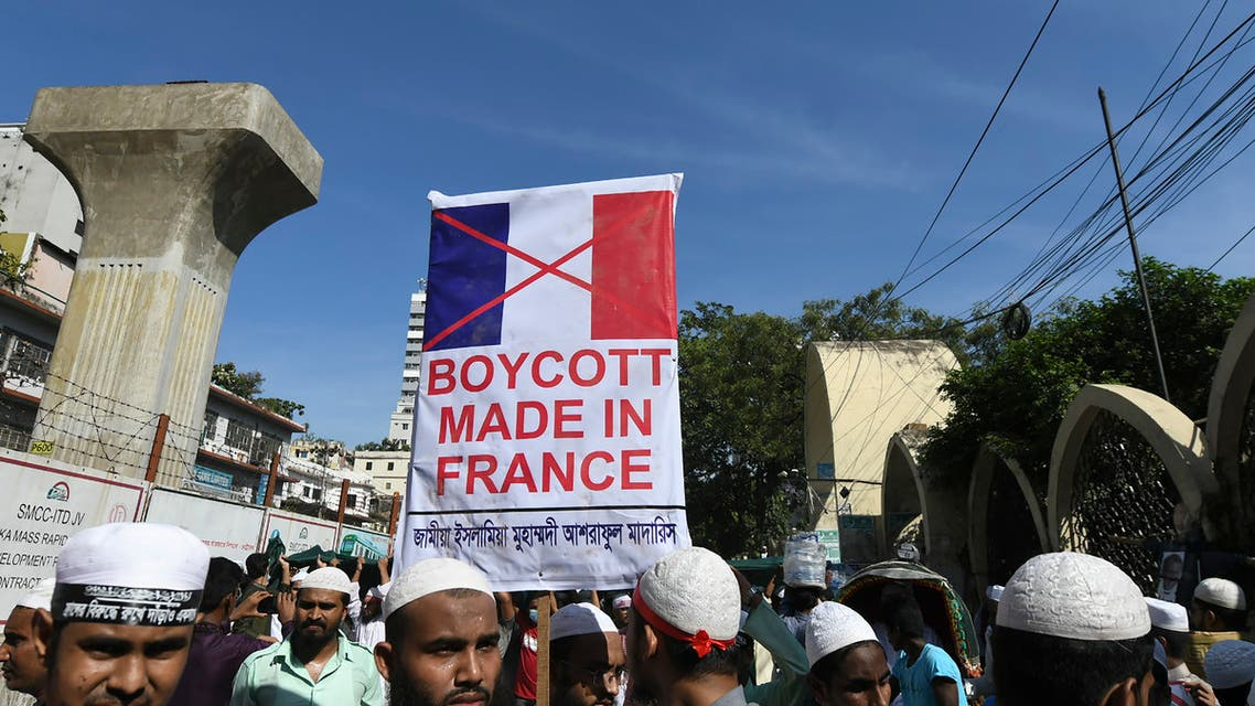 Protestors hold banners and shout slogans during a demonstration calling for the boycott of French products and denouncing French President Emmanuel Macron in Dhaka on October 30, 2020. (AFP)