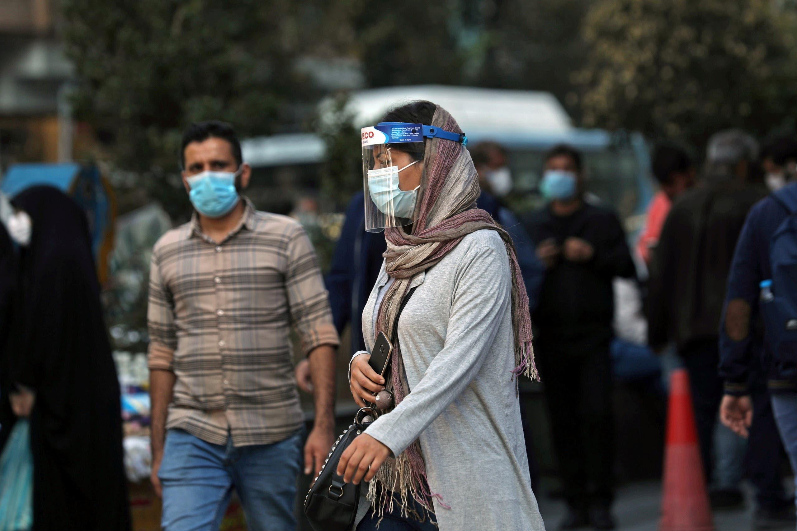 An Iranian woman wears a mask and face shield in Tehran, Iran October 24, 2020. (Majid Asgaripour/WANA via Reuters)