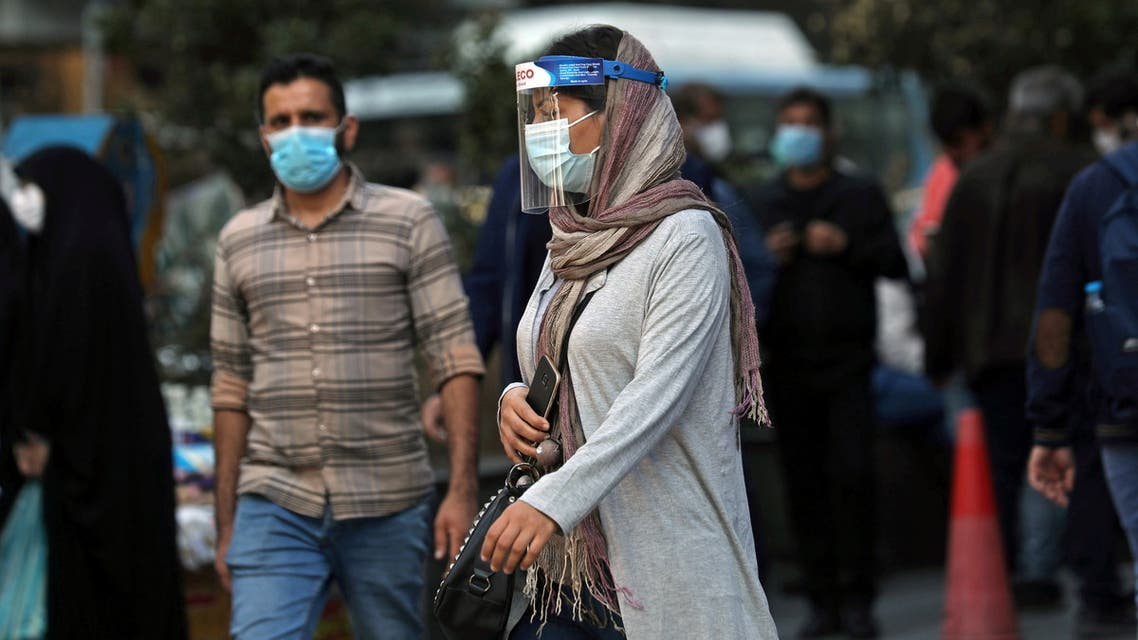 An Iranian woman wears a mask and face shield, amid a rise in the coronavirus disease (COVID-19) infections, in Tehran, Iran October 24, 2020. Picture taken October 24, 2020. Majid Asgaripour/WANA (West Asia News Agency) via REUTERS ATTENTION EDITORS - THIS IMAGE HAS BEEN SUPPLIED BY A THIRD PARTY.
