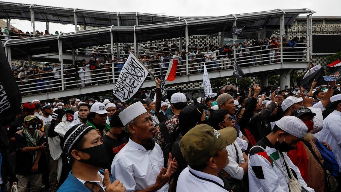 People gather during a protest against the comments of French President Emmanuel Macron considered insulting to the Prophet of Muhammad and Muslims, on the main road near the French Embassy in Jakarta, Indonesia, on November 2, 2020. (Reuters)