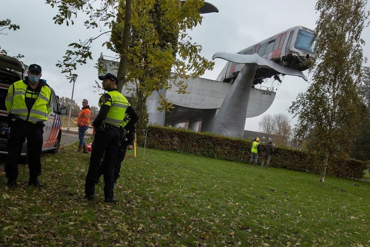 The whale's tail of a sculpture caught the front carriage of a metro train. (AP)
