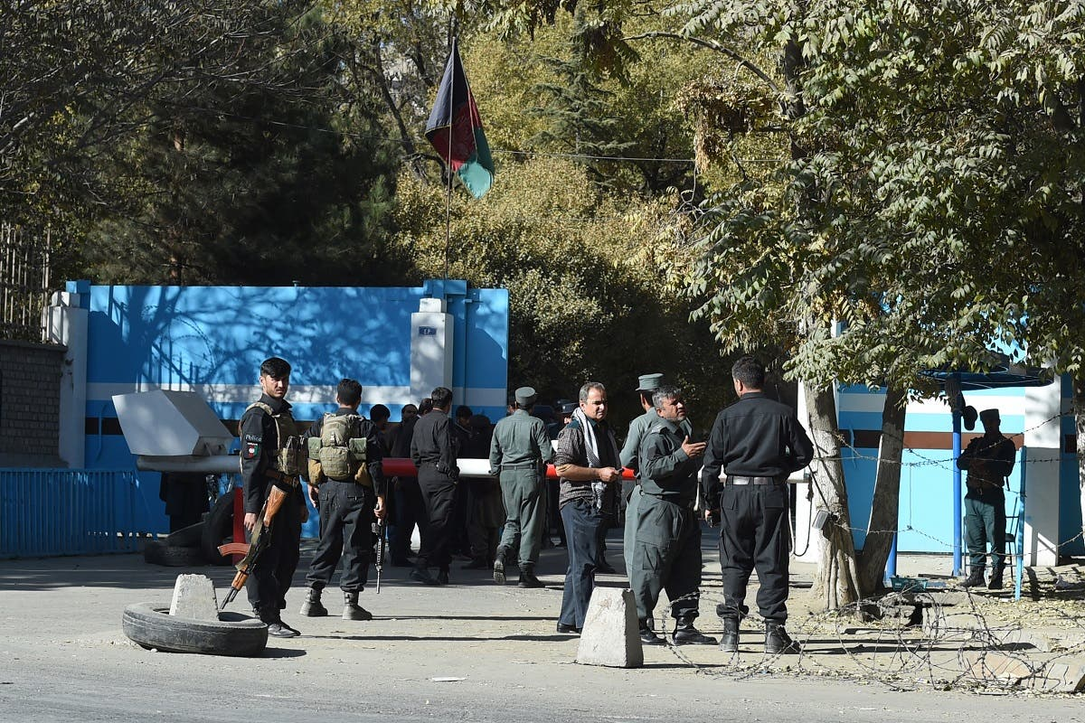 Policemen stand guard at an entrance gate of the Kabul University in Kabul on November 2, 2020. (Wakil Kohsar/AFP)