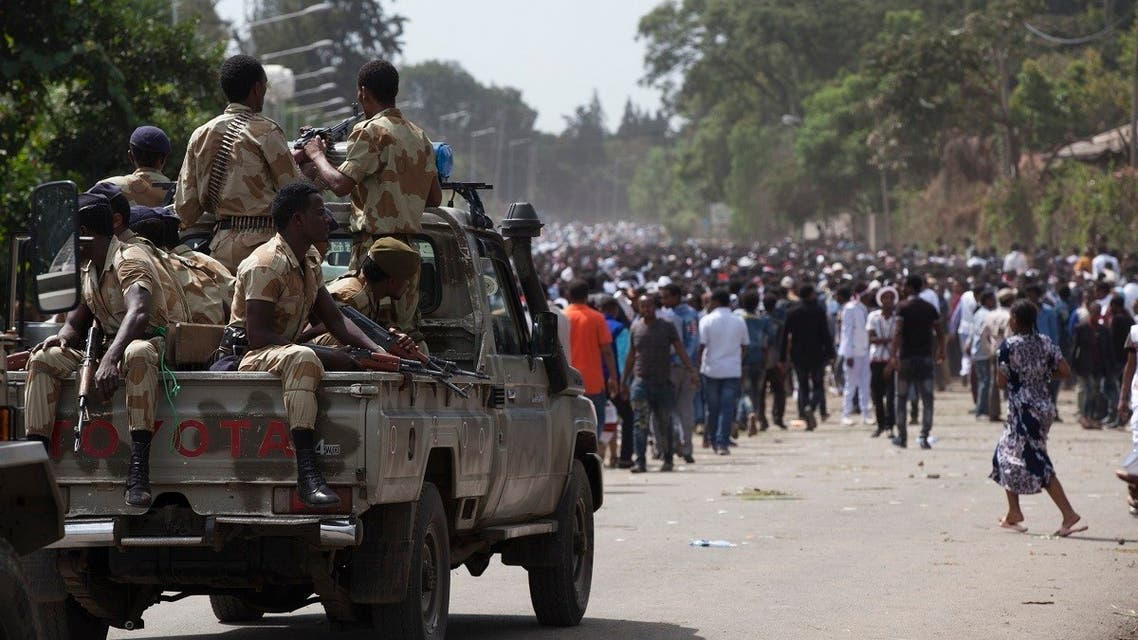 A file photo of Oromo regional police officers wait in a pickup car during the Oromo new year holiday Irreechaa in Bishoftu on October 2, 2016. (Zacharias Abubeker/AFP)