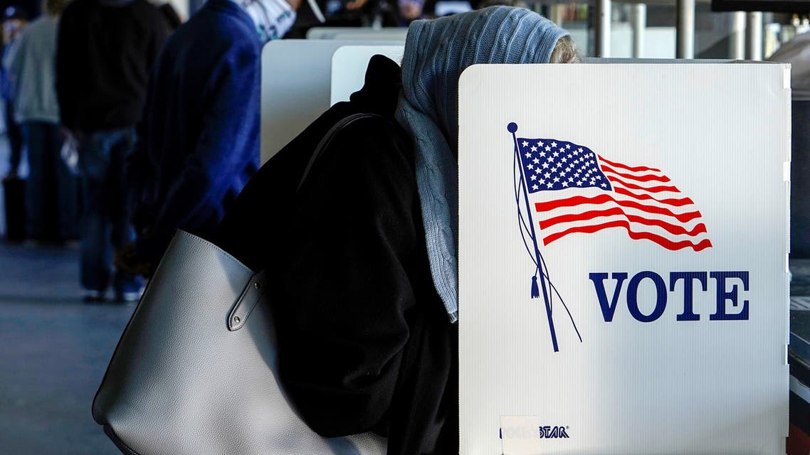 FILE PHOTO: A voter fills out her ballot during early voting at ONEOK Field in Tulsa, Oklahoma, U.S., October 30, 2020. REUTERS/Nick Oxford/File Photo