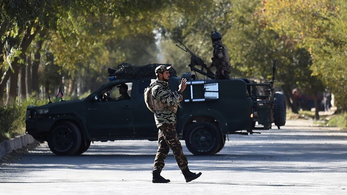 A security personnel stands guard outside the Kabul University in Kabul on November 2, 2020. (Wakil Kohsar/AFP)