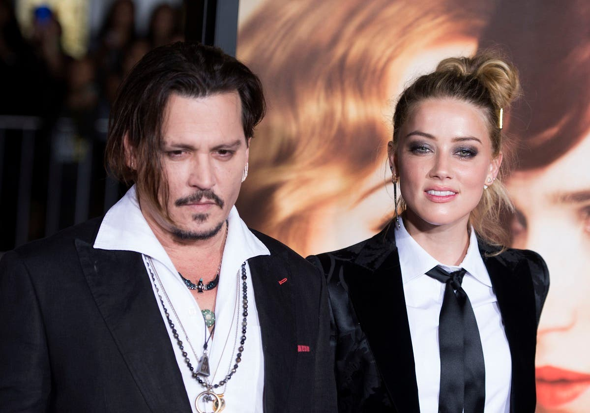"In this file photo taken on November 22, 2015 Actors Johnny Depp (L) and Amber Heard attend the Los Angeles Premiere of ""The Danish Girl"", in Westwood, California, on November 21, 2015. (Valerie Macon/AFP)"