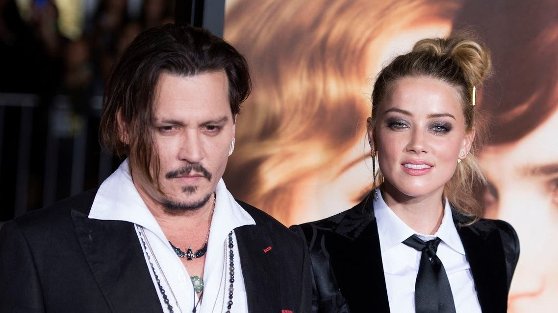 """In this file photo taken on November 22, 2015 Actors Johnny Depp (L) and Amber Heard attend the Los Angeles Premiere of """"The Danish Girl"""", in Westwood, California, on November 21, 2015. (AFP)"""