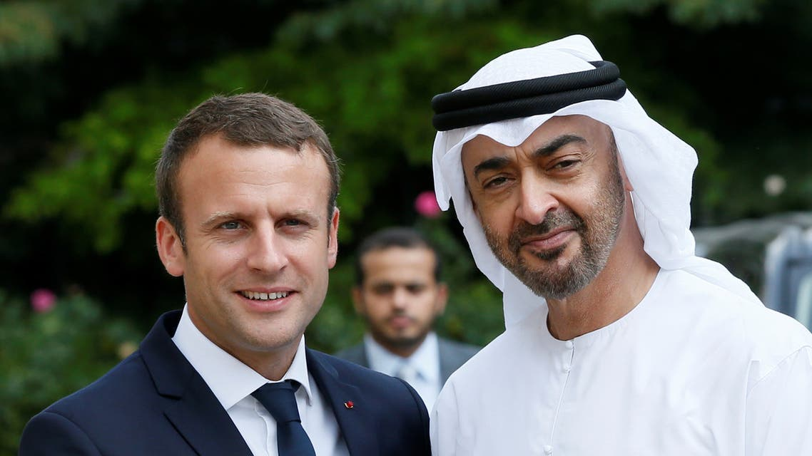 French President Emmanuel Macron accompanies Abu Dhabi's Crown Prince Sheikh Mohammed bin Zayed al-Nahyan after a meeting about Qatar crisis at the Elysee Place in Paris. (reuters)
