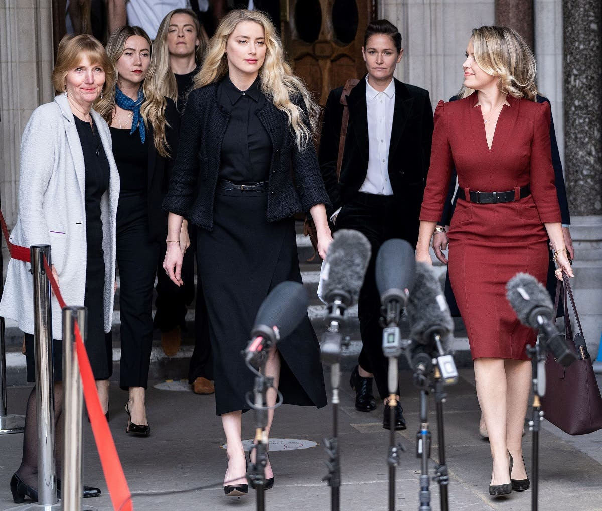 In this file photo taken on July 28, 2020 US actress Amber Heard (C) prepares to make a statement to members of the media outside the High Court in London, on July 28, 2020. (Niklas Halle'n/AFP)
