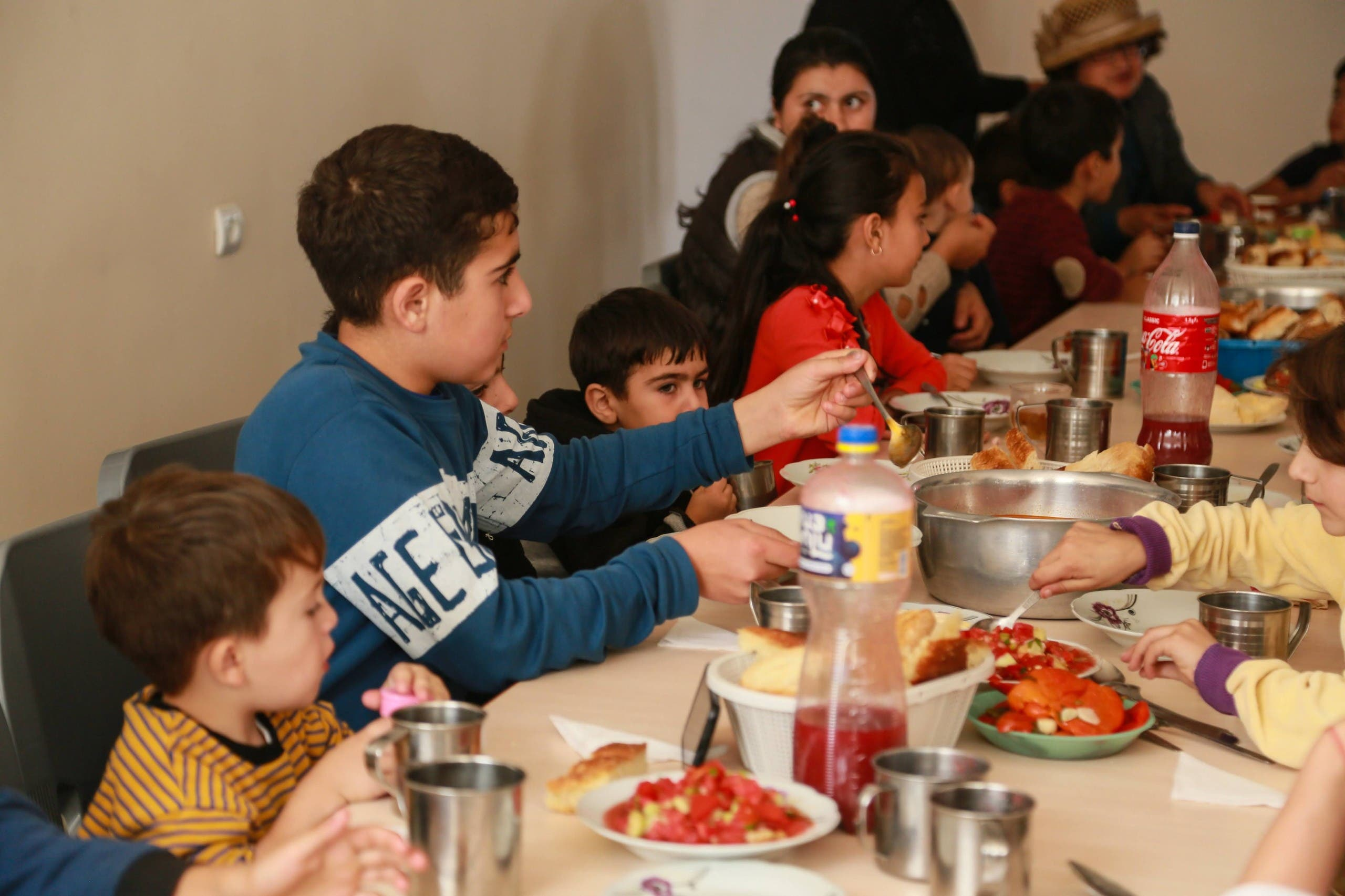 A meal at the Displacement Camp Armenian Missionary Association of America. (Supplied by the organization)