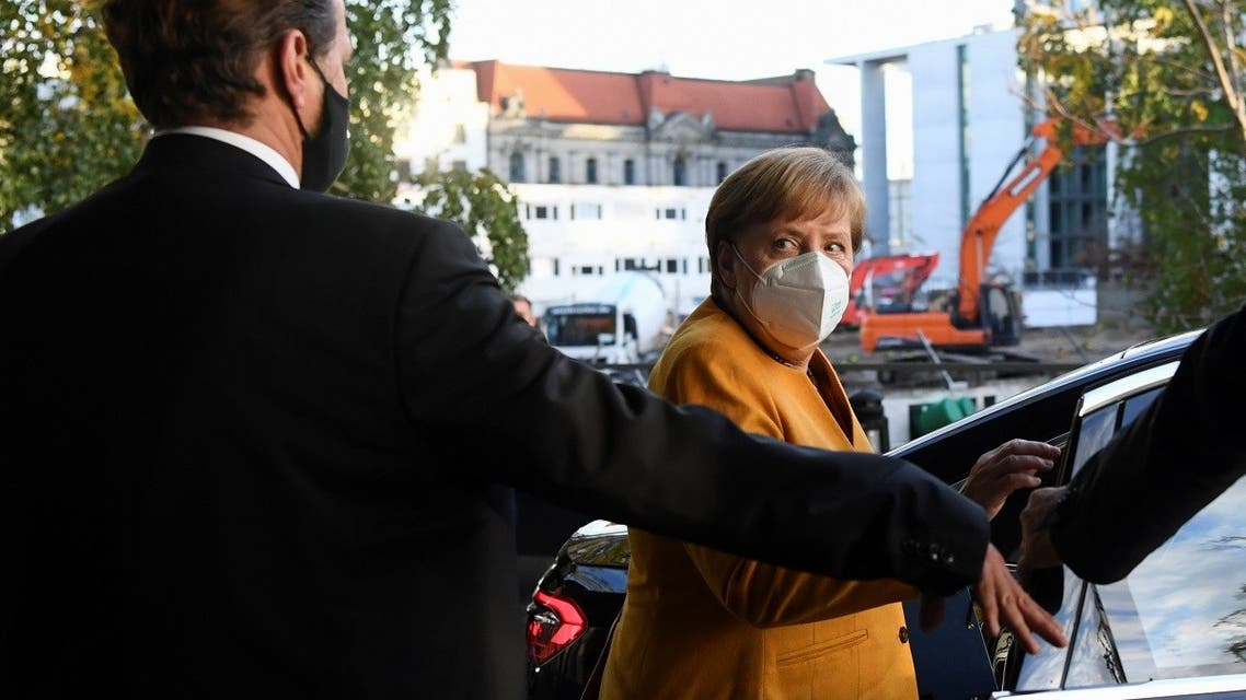 German Chancellor Angela Merkel leaves at the end of a news conference at the Bundespressekonferenz after discussing with her cabinet new measures to contain the spread of the coronavirus, in Berlin, Germany, on November 2, 2020. (Reuters)