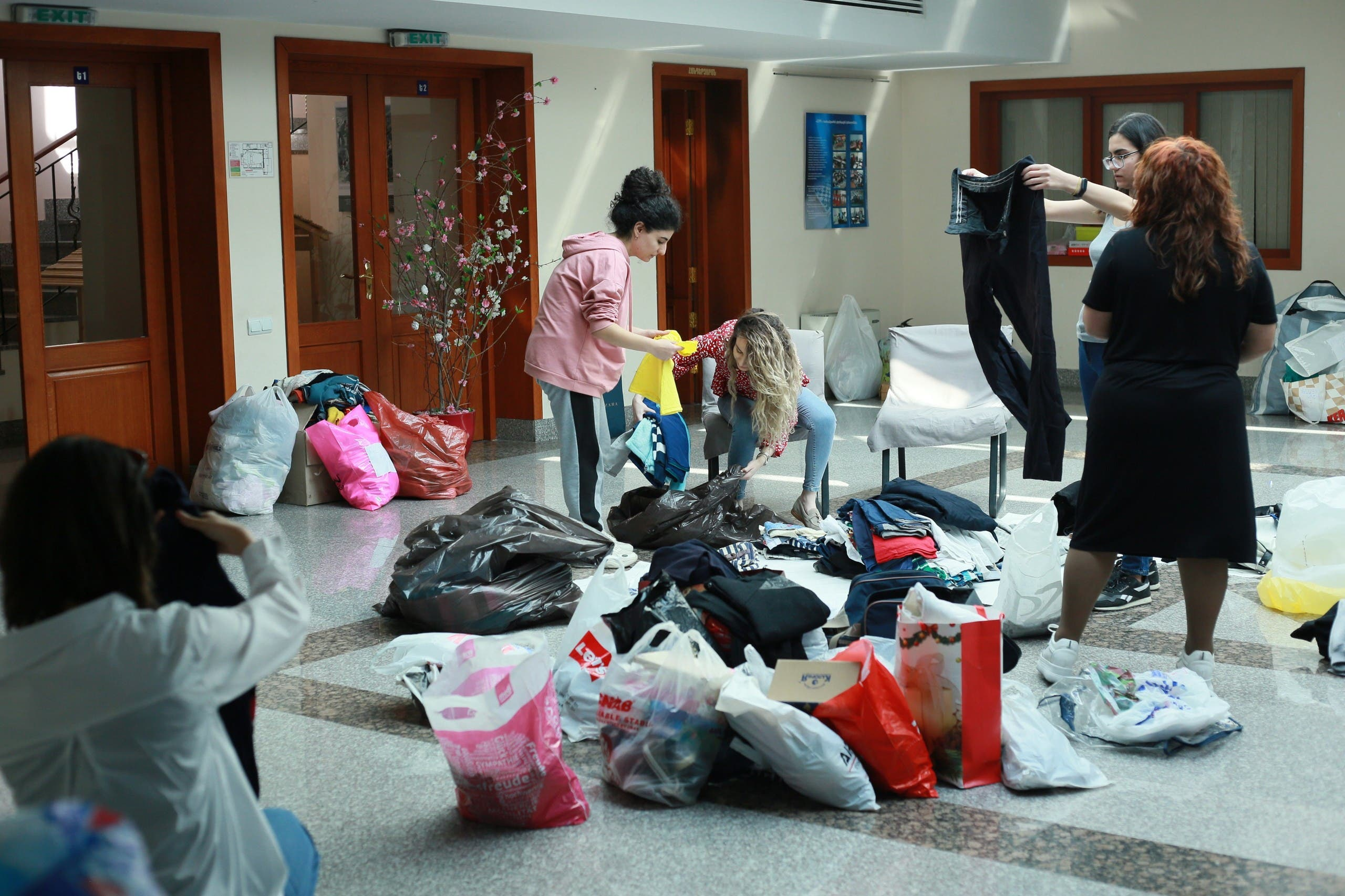 Women sort clothes for evacuees at the Displacement Camp Armenian Missionary Association of America. (Supplied by the organization).