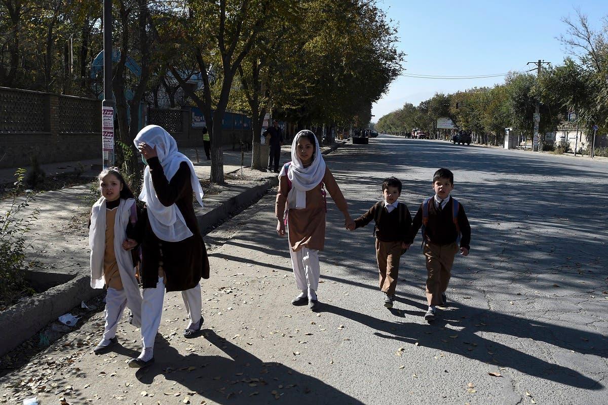 School children walk along a road near Kabul University in Kabul on November 2, 2020. (Wakil Kohsar/AFP)