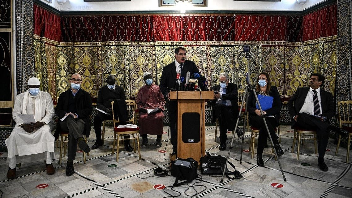 President of the Rassemblement des Musulmans de France (RMF) Anouar Kbibech (C) addresses a press conference, called by several national Muslim federations at the Great Mosque in Paris on November 2, 2020. (Christophe Archambault/AFP)