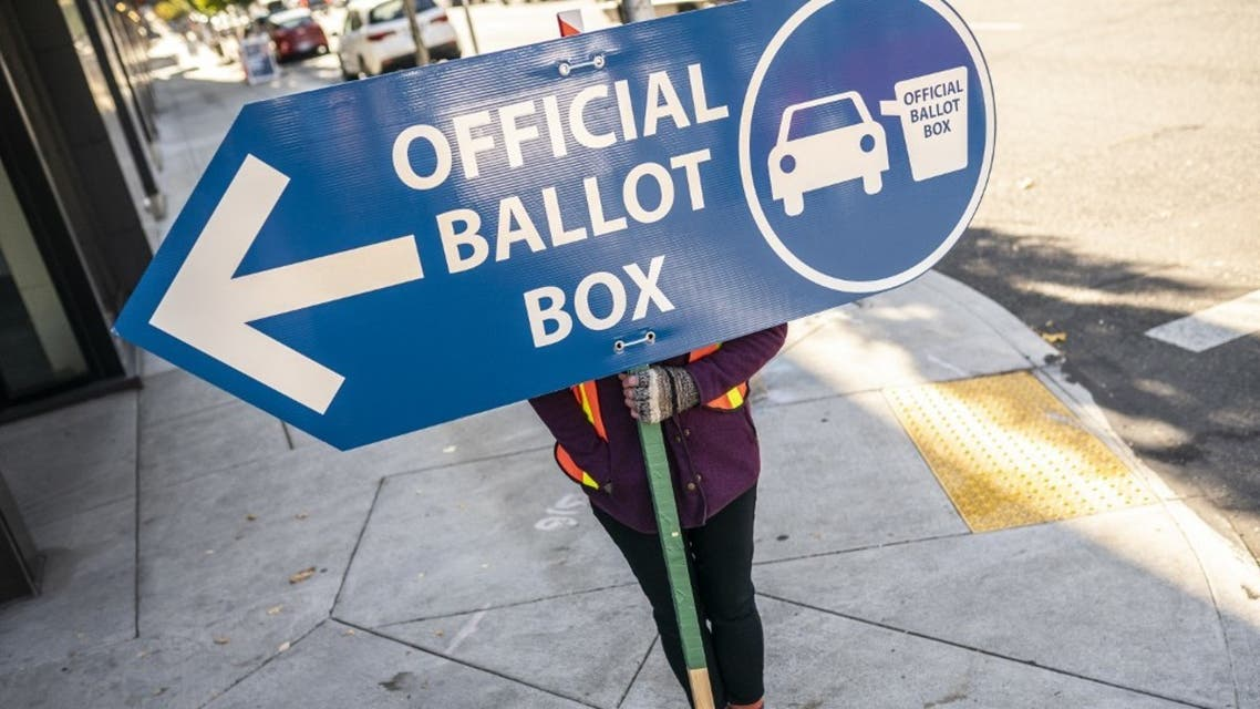 An election worker directs voters to a ballot drop off location on November 2, 2020 in Portland, Oregon. (AFP)