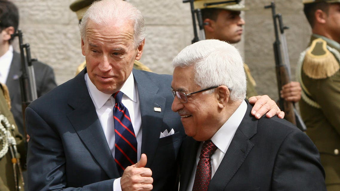 Then-US Vice President Joe Biden, left, gestures as he walks with Palestinian President Mahmoud Abbas ahead of their meeting in Ramallah on March 10, 2010. (File photo: AP)