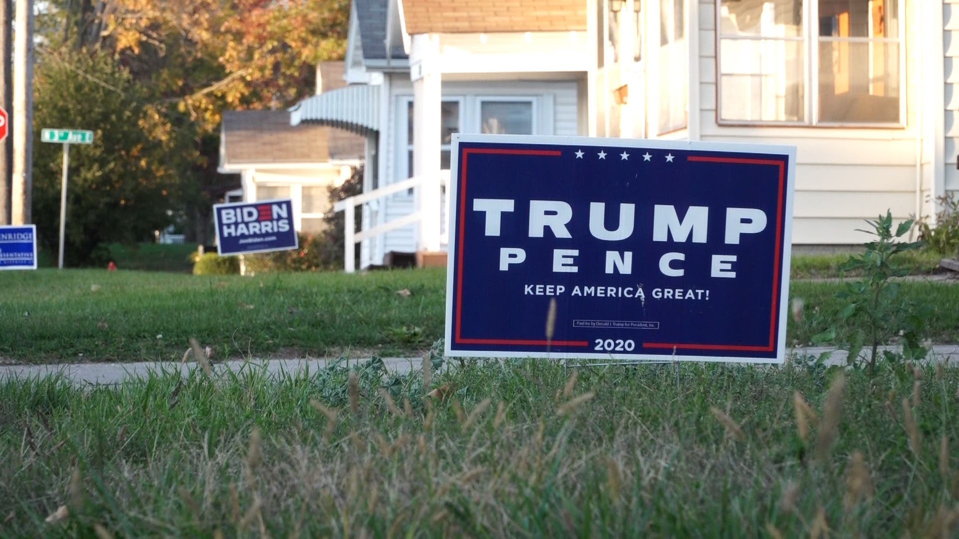 Signs in support of the candidate seen on lawns. (File photo: AFP)