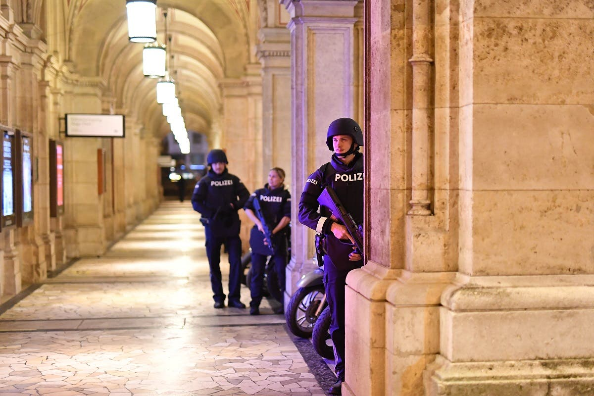 Armed police patrol at a passage near the opera in central Vienna on November 2, 2020, following a shooting near a synagogue. (Joe Klamar/AFP)