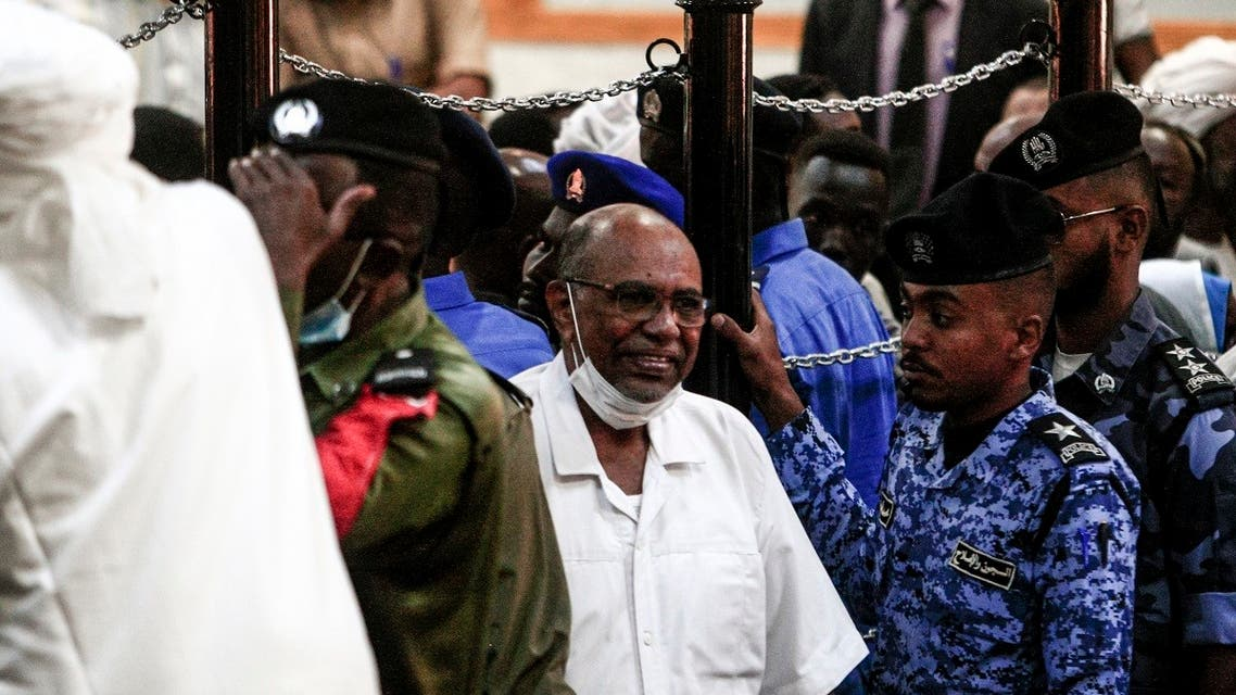 Omar al-Bashir (C) appears during his trial in Khartoum, Sudan, November 3, 2020. (Ebrahim Hamid/AFP)