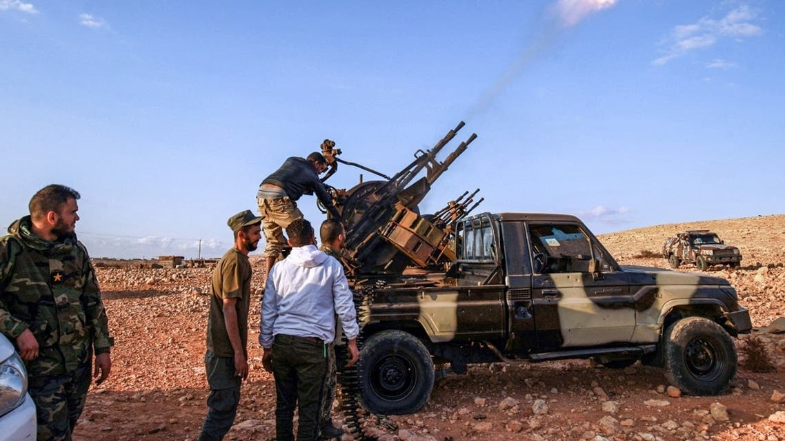 An anti-aircraft gun fires rounds in tribute during the funeral of General Wanis Bukhamada, commander of the Saiqa (Special Forces) of the Libyan National Army (LNA) loyal to strongman Khalifa Haftar, in the eastern city of Benghazi on November 1, 2020. (AFP)