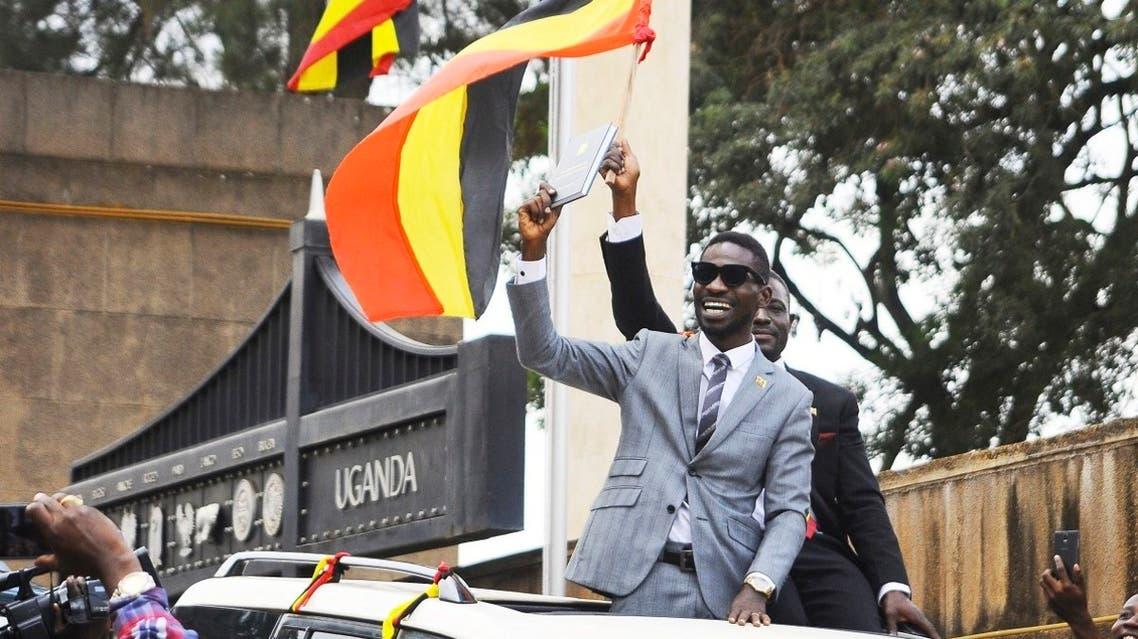 Ugandan pop star Kyagulanyi Ssentamu, better known as Bobi Wine, center, gestures to supporters in Kampala, Uganda. (File photo: AP)