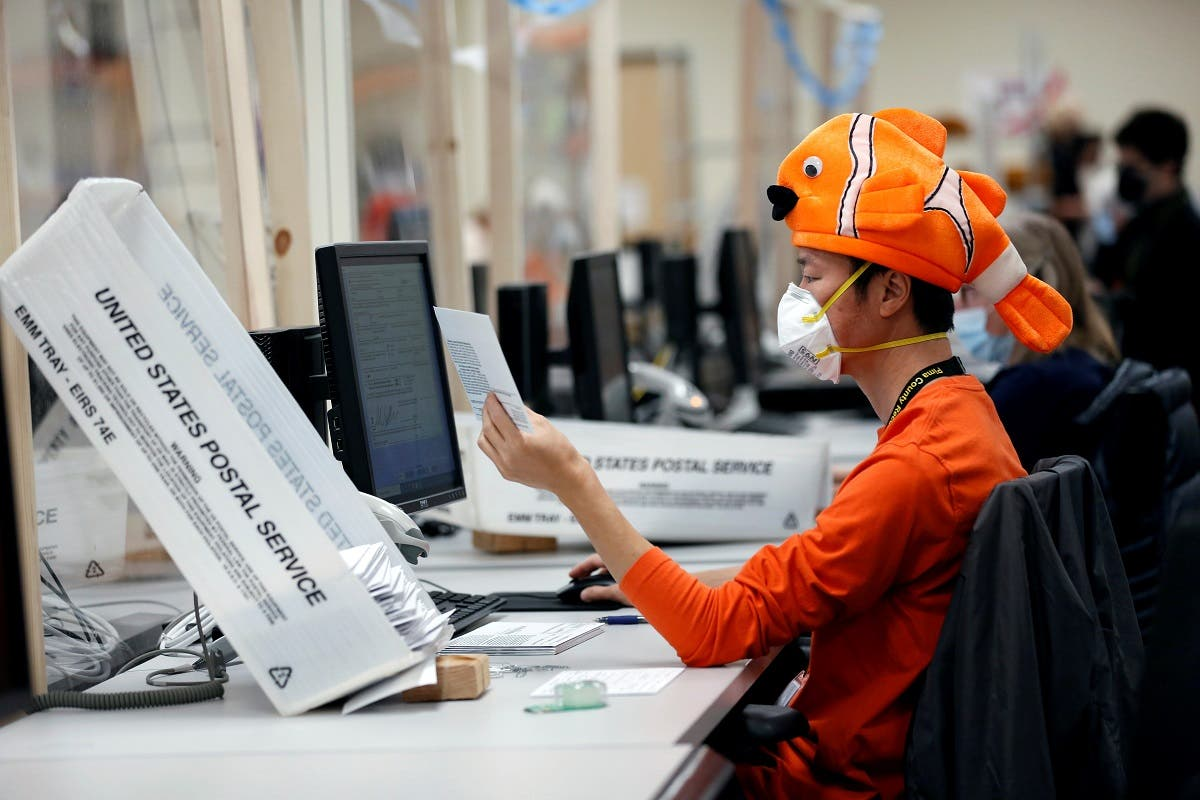 An employee wears a Halloween costume while processing early voting and absentee ballots ahead of the presidential election in Tucson, Arizona, Oct. 31, 2020. (Reuters)