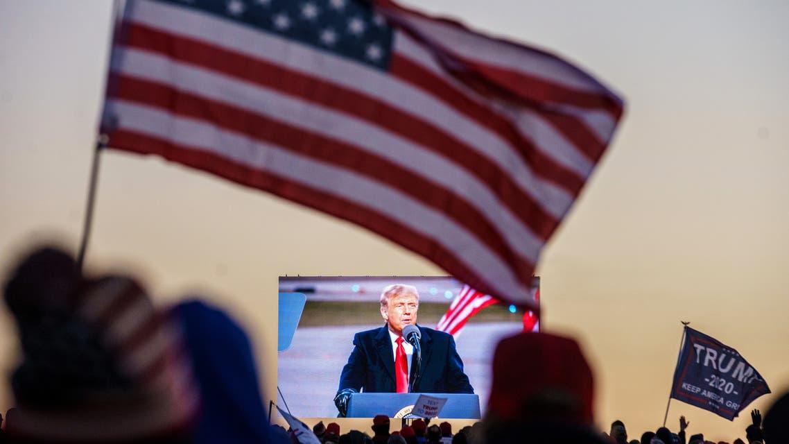 US President Donald Trump, rally, American flag - US Elections (AFP)
