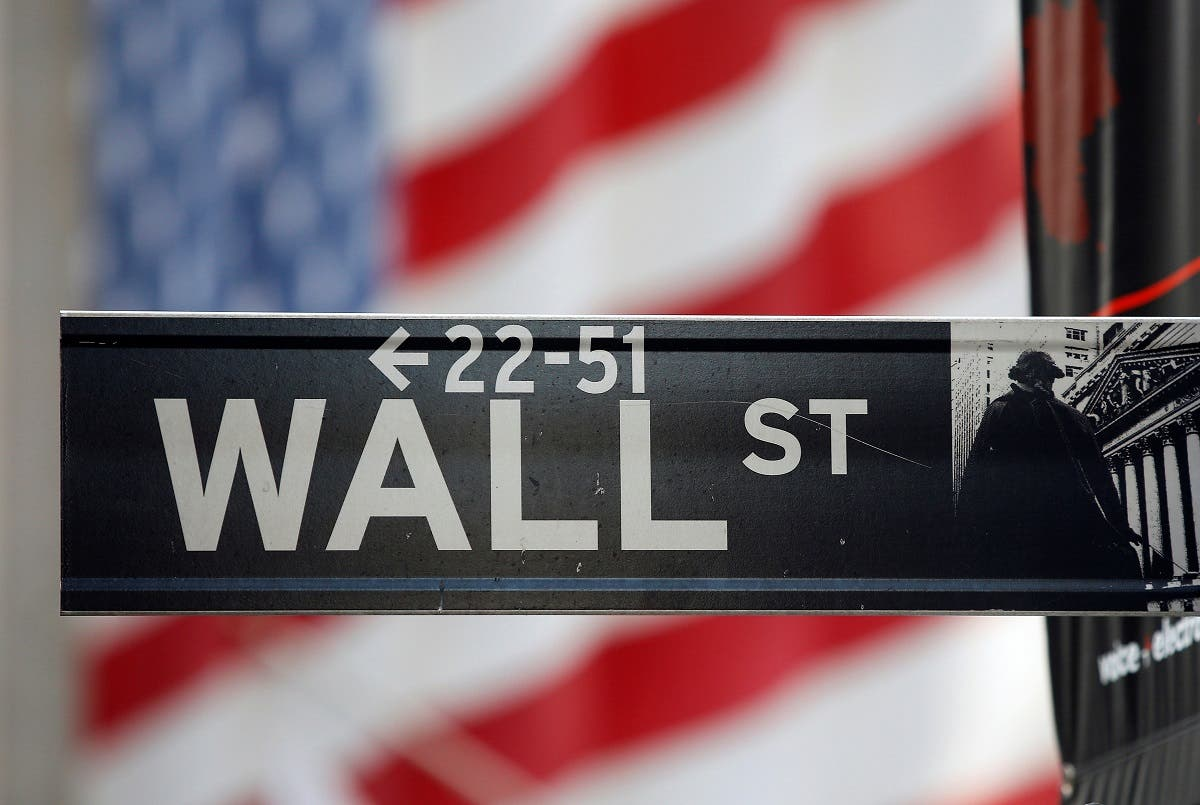 A sign for Wall Street is seen with an American flag in the background across from the New York Stock Exchange. (File Photo: Reuters)