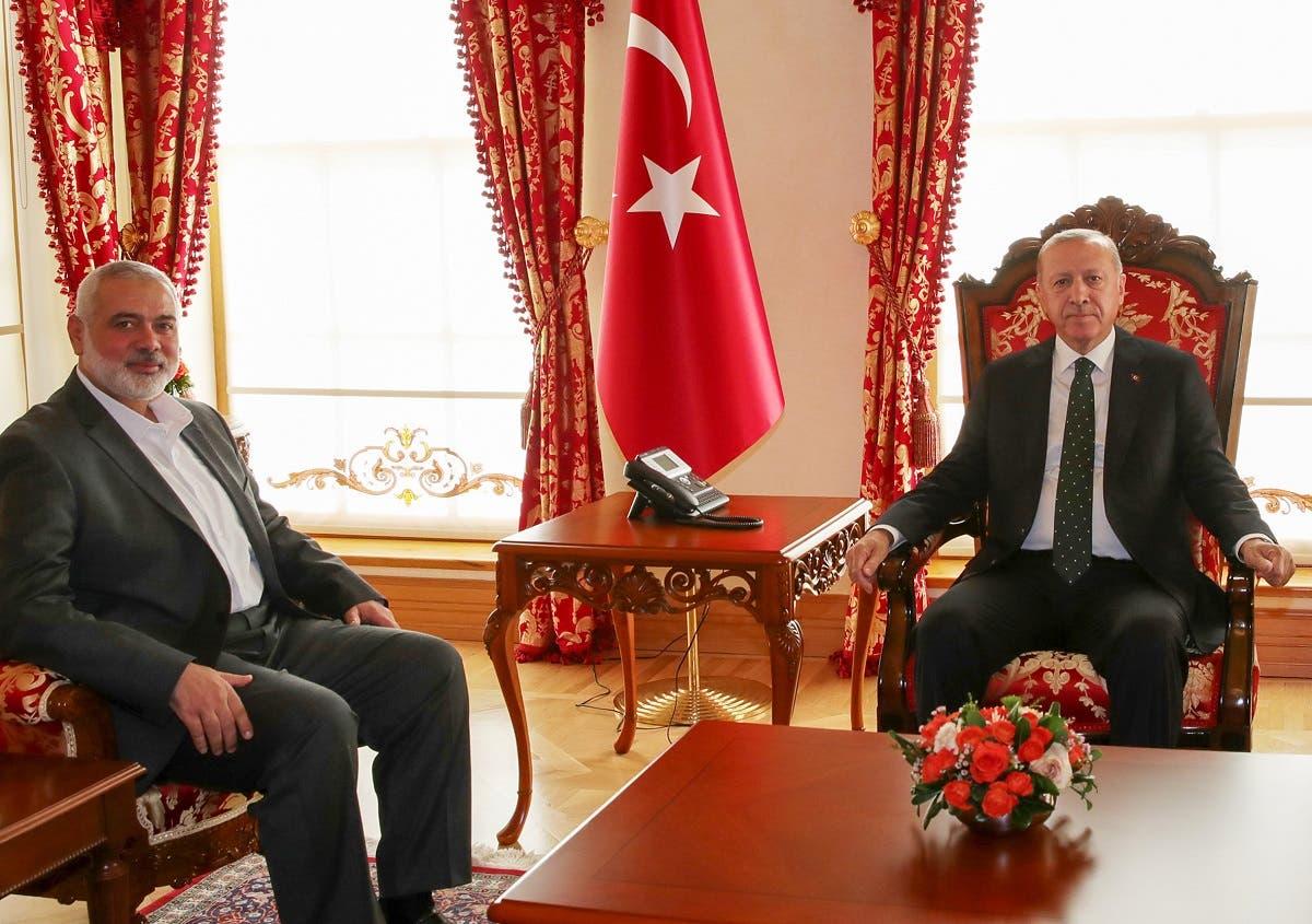 Turkey's President Recep Tayyip Erdogan (R) and Hamas's political bureau chief Ismail Haniya (L) during their meeting in Istanbul, December 14, 2019. (AFP)