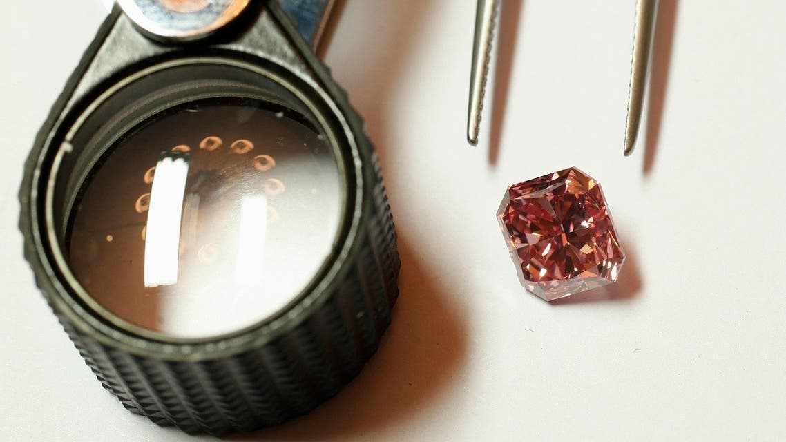A Rio Tinto pink diamond is displayed along with tweezers and a magnifier in Hong Kong. (Reuters)