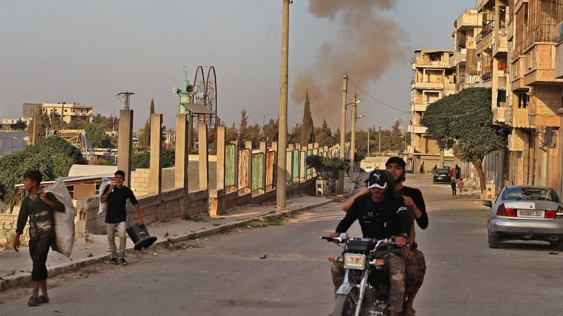 A smoke plume rises following an explosion in the town of Ariha in the opposition-held northwestern Idlib province on October 20, 2020. (Abdulaziz Ketaz/AFP)