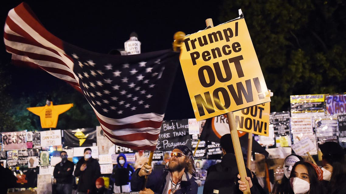 Demonstrators rally at Black Lives Matter plaza across from the White House on election night in Washington, DC on November 3, 2020. (AFP)