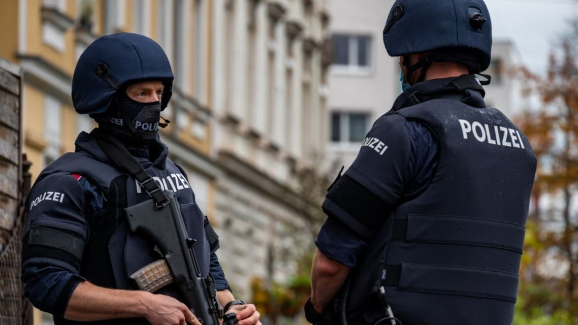 Policemen stand in front of a residential building in Linz, Austria, where a man was detained on November 3, 2020 in connection with the Vienna shooting one day before.  (AFP)