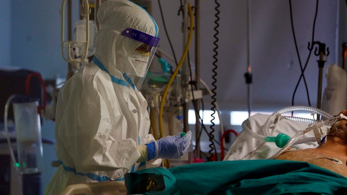 A medical staff tends to a patient inside the COVID-19 intensive care unit at the San Filippo Neri hospital in Rome, on November 3, 2020. (AP)