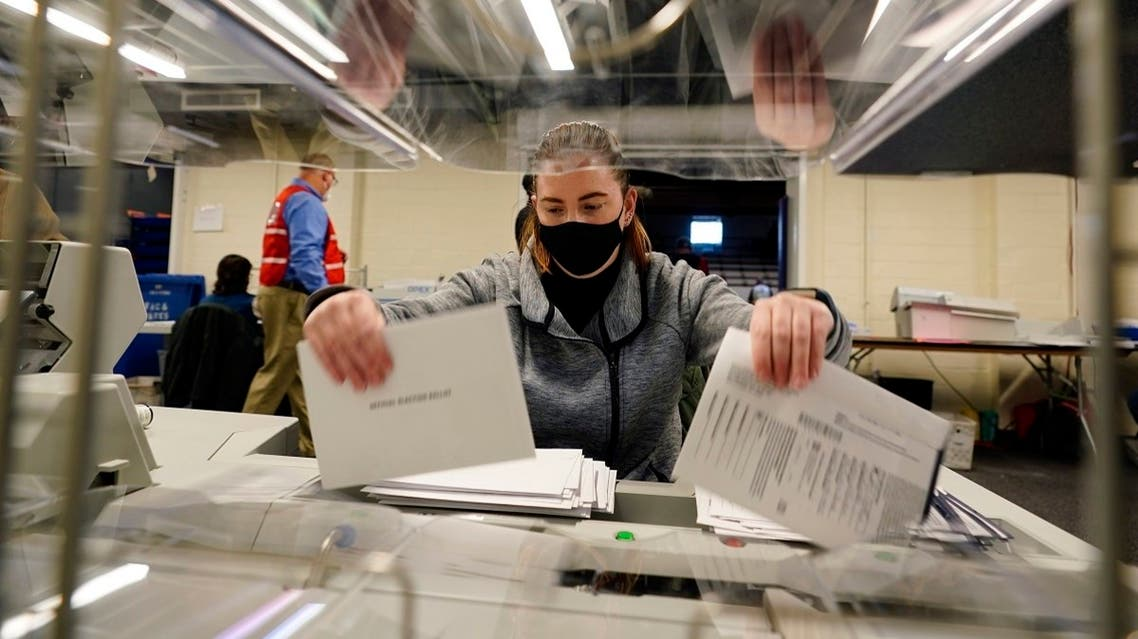 An election worker opens mail-in and absentee ballots for the 2020 General Election, Nov. 3, 2020, in West Chester, Pennsylvania. (AP)