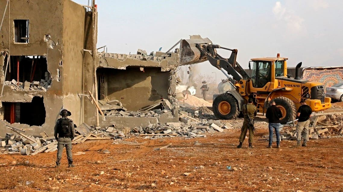 Israeli machinery demolish a Palestinian house located within the area C (where Israel retains control, including over planning and construction) in a village south of Yatta in the southern area of the West Bank town of Hebron, on November 2, 2020. (Hazem Bader/AFP)