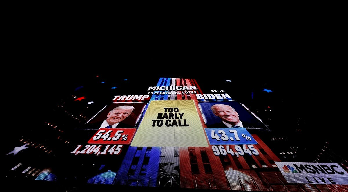 A giant television screen shows a network TV broadcast showing the presidential race in Michigan as too close to call, Nov. 3, 2020. (Reuters)