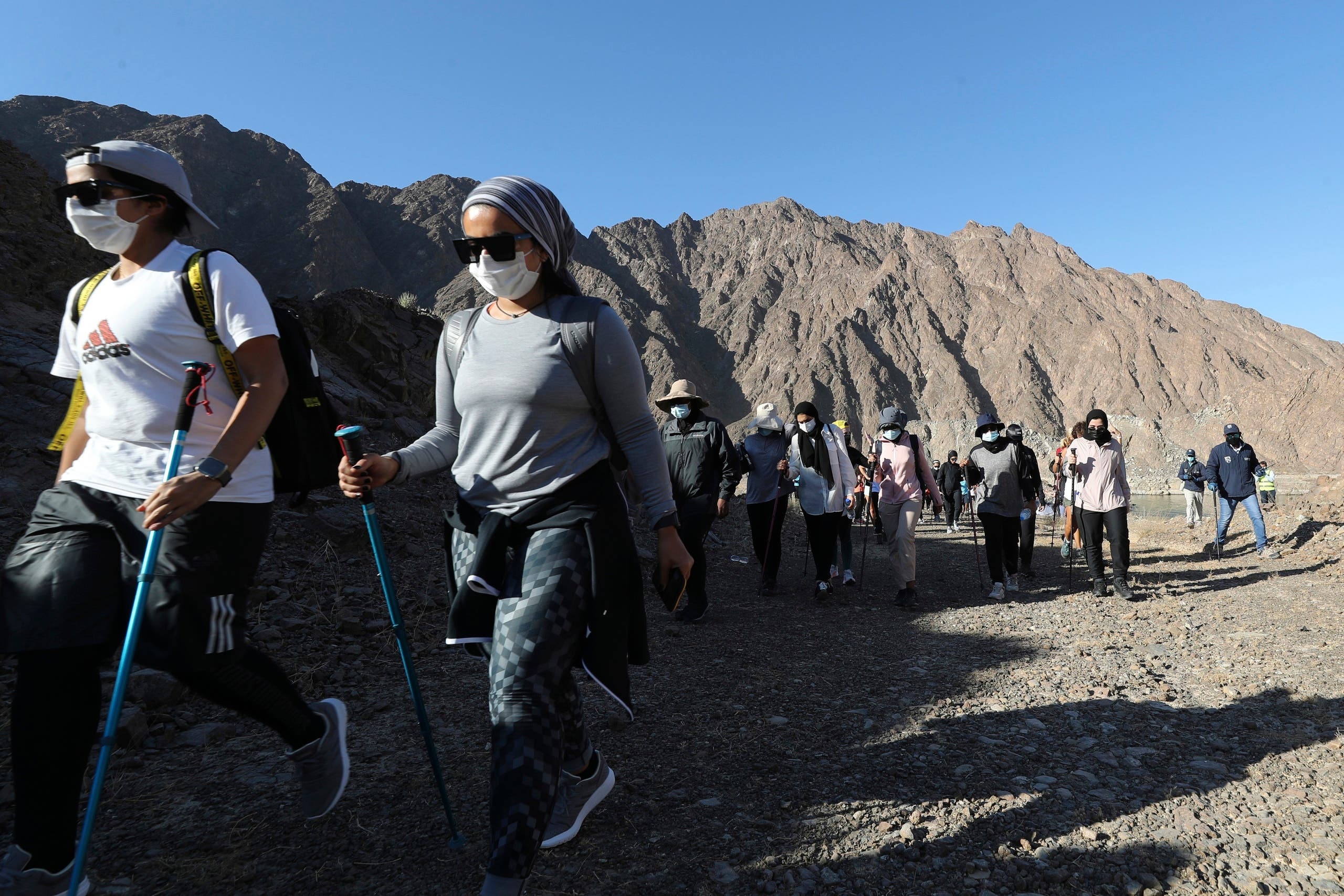 Participants walk during the Women's Adventure Hatta organized by Dubai Sports Council in Hatta, United Arab Emirates on Oct. 23, 2020. (AP)