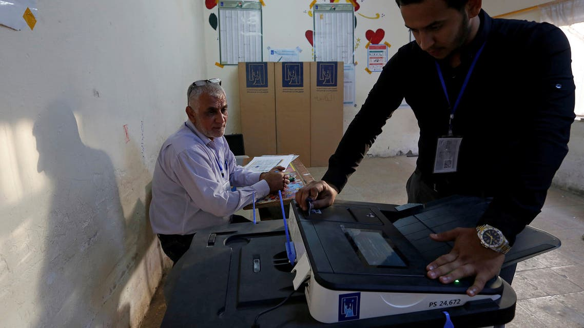 Iraq's Independent High Electoral Commission employee closes a ballot box at a polling station during the parliamentary election in the Sadr City district of Baghdad, Iraq May 12, 2018. REUTERS/Wissm al-Okili